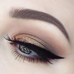 Gold eye look with sleek wing.
