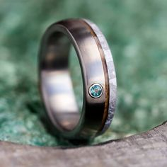Whiskey barrel oak wood and genuine meteorite decorate this exotic Alexandrite wedding band. The angular patterns in the Gibeon meteorite complement titanium. Shop this unique men's wedding band and of others online. Baguette Ring, Baguette Diamond Rings, Morganite Engagement, Diamond Engagement Rings, Wedding Men, Wedding Suits, Wedding Attire, Wedding Ideas, Dream Wedding