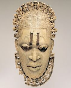 Waist Pendent Depicting A Queen Mother, Benin, 15th-16th Century. Ivory, Iron. Height 25cm    Queen mother Idia, wife of oba Ozolua and mother of oba Esigie.