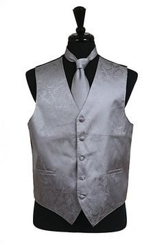 Men's Gray Paisley Vests with Neck Tie are a must-have when you need to look dashing for a wedding, prom, or for any other formal occasion. These paisley vests feature a sophisticated tone-on-tone pai