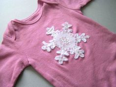 Snowflake applique for a onesie but could go onto anything.