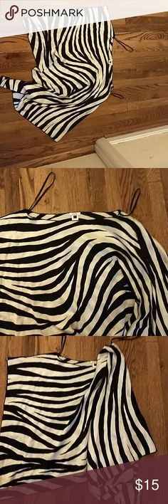 Cache asymmetrical zebra stripe top size large This is such a cool shirt and I cannot get it to lay right but you can imagine it hangs down longer on one sleeve kind of off the shoulders a little bit very sexy 100% silk I never could find a way to wear this because it's a little big on me perfect shape Cache Tops Blouses