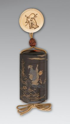 Inrō, Ojime, Netsuke Kajikawa School (Japan, active 17th to 19th centuries) Japan, 17th century [inrō] lacquer; [ojime] carved lacquer; [netsuke] ivory [inrō] 3 1/2 x 1 7/8 in. (8.9 x 4.8 cm)