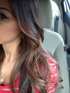 Light brown hair color. Carmel highlights. Soft curls.