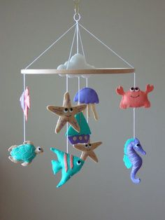 Nautical Sealife Baby Mobile by ClooneyCrafts on Etsy https://www.etsy.com/uk/listing/399573509/nautical-sealife-baby-mobile