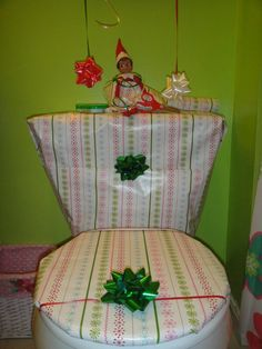 elf on shelf wrapped toilet