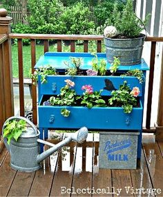 Love the idea of using old dressers as planters. Brings color and style to the garden with this junk art.