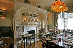 Plenty of Anglo-charm: The Ingle Nook dining room at the Dandelion at 18th and Sansom, Stephen Starr's newest offering, a British-themed pub. (AKIRA SUWA / Staff Photographer)