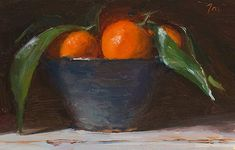 Clementines in a blue bowl