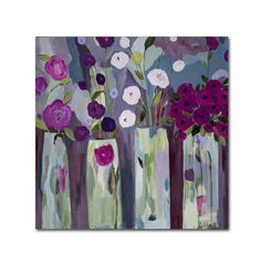 This ready to hang, gallery-wrapped art piece features a painting of colorful flowers in vases. Carrie Schmitt has loved flowers since her childhood and today paints them as part of her mission to cre