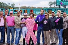 Close friends and co-workers, including the late Dr. Rosalyn Randall's companion Bob Paterno, greet the winning connections after the 7th race, the Susan G. Komen for the Cure Purse in memory of Dr. Randall, the track's long-time Association Veterinarian, who passed away last spring of breast cancer. Cindy Patrick's gelding, Hiyaben, trained by R. Gary Patrick and ridden by apprentice jockey Ricardo Mejias, won the wreath of pink daisies! (February 16, 2013)