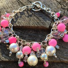A beautiful bracelet just full of pink beads & faux pearls! Each bead is hand wired & attached to a silver plated chain. Has a toggle closure. You'll definately be noticed with this one. Only 1 available! Get it before it's gone!