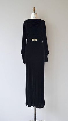 Vintage 1930s jet black silk velvet dress, bias cut with draped neckline, long sleeves with extended loop button cuffs, side metal closures and matching belt with classic deco rhinestone belt buckle. --- M E A S U R E M E N T S --- fits like: medium bust: 34-38 waist: 30-32 hip: 41