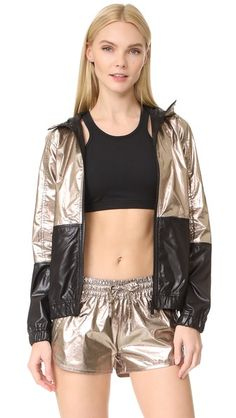 ¡Consigue este tipo de abrigo de lana de ALALA ahora! Haz clic para ver los detalles. Envíos gratis a toda España. ALALA Metallic Woven Jacket: An iridescent, rose gold-tone finish lends a eye-catching effect to this sporty ALALA windbreaker. An exposed plastic zip secures the hood and placket, and covered zips close the hip pockets. Covered elastic waist and cuffs. Unlined. Fabric: Coated weave. Shell: 100% cotton. Trim: 100% polyester. Hand wash. Imported, China. Measurements Length…