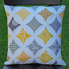Yellow & Grey Cathedral Windows Pillow, via Flickr.