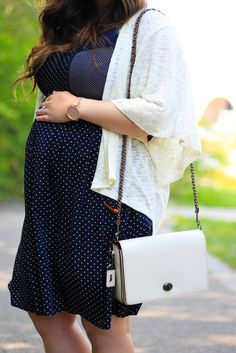 Maternity fashion in polka dots and Coach.