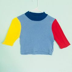 UNIF Mork Top - Crop Top Color: Blue/Yellow/Red Size: Large This shirt is no longer for sale on the UNIF site so it's a rare find. A nice color blocked design and statement piece. I also posted a photo from the site of their model to reference its length since it is a Crop Top #unif #style #fashion #colorblock #primary