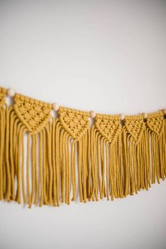 This macrame garland is made from natural mustard cotton rope with wooden beads and is a beautiful addition to a room, childs nursery or as a party decoration. Hanging above a couch, as a headboard to a bed, above a crib, the possibilities are endless. A standard size garland comes with 6
