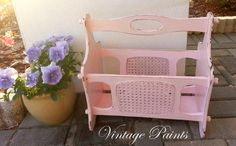 Vintage magazine rack painted pink and distressed.  #shabby #chic