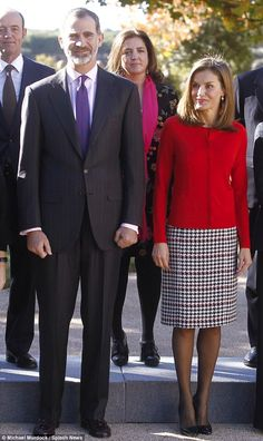 The royal pair posed together during a visit in Madrid. The mother-of-two wore a fashionable houndstooth dress