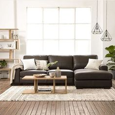 Global living with our Jensen 2.5 seater sofa with chaise paired with the Kote coffee table and storage unit #ozdesign #ozdesignfurniture #sofas #homefurnishings #leather #interiordesign #global #homedesign #rustic #botanicals #home #living #raw #organic #texture #trend #homedecor #homewares #interiordesign #F4F #FF #design #home