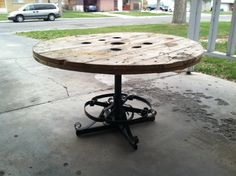 Large lazy Susan made by bolting one side of a wire spool to the swivel and stand from a bar stool.