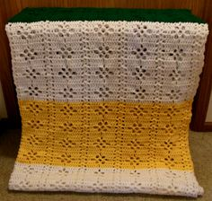 Hand-made afghan in lovely Packer colors!