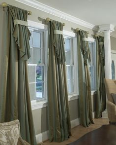 Icky fabric/color, but would be so pretty in between bay windows  Contrast banding provides a striking detail