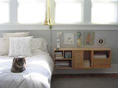 Shelly Klein (of K Studio)'s bedroom repetition: 3 in row, wall-mounted boxes