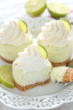 These Mini Key Lime Cheesecakes feature an easy homemade graham cracker crust topped with a smooth and creamy key lime cheesecake filling. The perfect dessert for any time of year! These Mini Key Lime Cheesecakes feature an easy Key Lime Desserts, Easy Desserts, Delicious Desserts, Summer Desserts, Key Lime Pie Cheesecake, Mini Cheesecake Recipes, Cheesecake Bites, Single Serving Cheesecake Recipe, Cheesecake Cupcakes