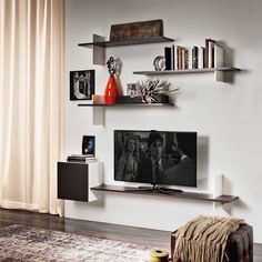 Cross, complemento by CATTELAN ITALIA.