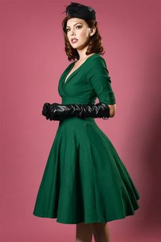 You'll feel like the most beautiful woman when wearing this 50s Delores Swing Dress in Emerald Green! You'll steal the show when wearing this retro stunner ;-) When you make your entrance in this beauty, all eyes will be on your stunning silhouette, the pleated wrap top and the elegant sleeves with darling details. Not only a fairytale to see but also to wear; she's made from a luxurious, stretchy, emerald green cotton blend for a lovely fit. Fabulously classy!  Swing style Lined, pleated…
