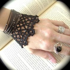 Tatted Cuff Bracelet - The Woman. $30 on etsy.   Falling in love with needle tatting. might have to learn how to crotchet