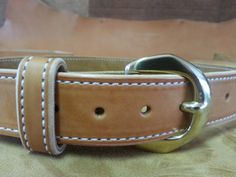 MADE TO ORDER just for you. Everyday wear and as a gun belt.  Unique solid Brass buckle Color: Natural Russet Thread: white bonded heavy duty nylon Full grain leather,100% made in the USA! Nothing imported!! Suede: English Toast  Please measure as shown: from the buckle latch to the hole you normally use. Please also include your pant size for stamping the leather. Lead time varies depending on the orders for the month. usually three to four weeks.  Dog collars are also available. just use…