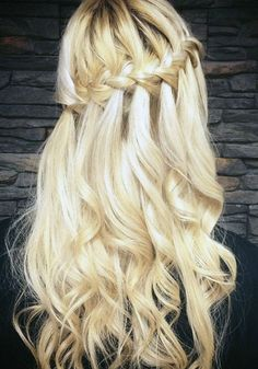 Curly tendrils add a fairy-tale feeling to this waterfall braided hairstyle.: