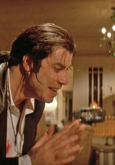 John Travolta as Vincent Vega in Pulp Fiction