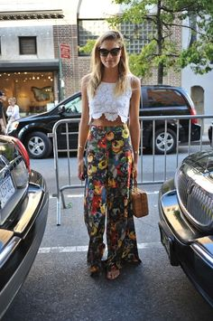 Gorgeous summer outfit - white lace crochet crop top teamed with a pair of high waisted floral flared trousers!!!