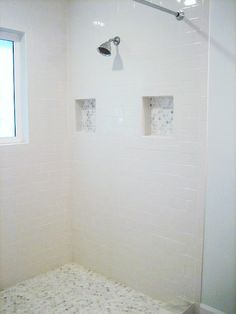 The floor tile and accents you see in this shower is Greecian White Hexagon from The Home Depot. See more of this bathroom remodel at the Ten June blog. || @tenjuneblog