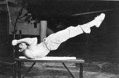 Bruce Lee performing the dragon flag