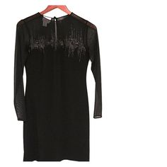 Donna Morgan black dress. NWOT. Dress features sheer panels and sequins (see additional image with Nina shoe listing). Length ~35 in sleeves are sheer ~22 in. long. Dry clean only. Donna Morgan Dresses