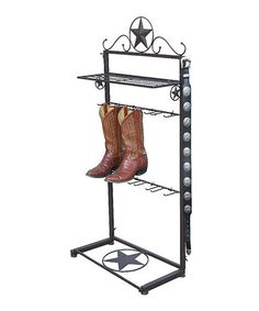 Metal Star Boot Rack Show off your boots in proper cowboy style with this wrought iron boot rack. Accommodates four pairs of boots, with hangers on either side and a handy shelf for your belts and other accessories.  Boots not included 25.5'' W x 49.5'' H x 11.25'' D Wrought iron  Western boots holder, display, horses, riding, quarter horse, roping, barrel racing, western pleasure, trail riding, super horse, congress, penning, barn, show, Texas, midwest