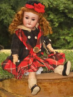For the luxury Paris Doll Shop  Au Nain Bleu  on pretty shy faced child Bebe in all factory original condition included very beautiful clothing ,
