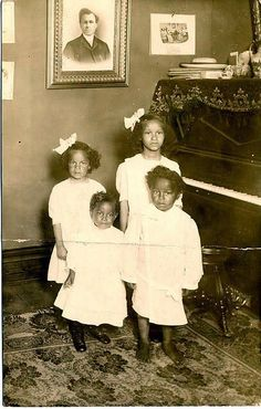 Four African American children, probably three girls and one boy, pose in a living room next to a piano in white dresses. Want to know more about Black History ? American Women, American Photo, American Children, Black Art, Vintage Black Glamour, Black History Facts, Black Families, African Diaspora, My Black Is Beautiful