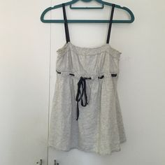 A&F Gray Tank With Navy Straps And Tie Abercrombie & Fitch gray tank top with navy straps and tie. Gently worn but still in great condition. Abercrombie & Fitch Tops Tank Tops