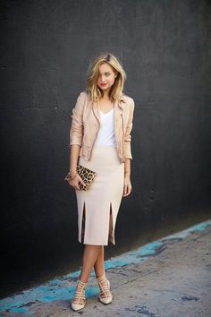 white top with nude jacket and skirt