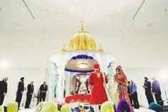 sikh indian wedding gurdwara decor  by Nimboo Photography via http://www.indianweddingsite.com/james-bond-themed-indian-wedding-south-asian-wedding-centre/
