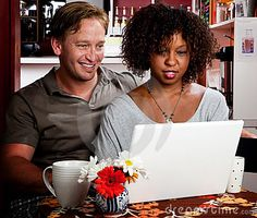 mixed race couples | Mixed Race Couple In Coffee House With Laptop Comp Royalty Free Stock ...
