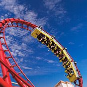 """The Roller Coaster    The Roller Coaster will lift you up 203 feet, drop you down 144 feet and leave you coasting at 67 mph. This Las Vegas ride experience simulates a jet fighter's barrel roll while taking you on the famous """"heartline"""" twist."""
