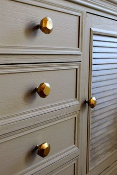 Inexpensive knobs sprayed with Rustoleum Gold.  Awesome before and after! Honey Haven: Entertainment Center Makeover