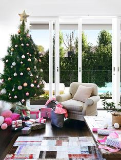 """""""We dedicate a whole day – the Saturday closest to the first of December – to decorating the house for Christmas,"""" says home owner and interior designer Jo McIntyre. """"We always have a huge tree and everyone tries to hang their own ornaments, the ones they made in kindergarten or primary school, in the most prominent position."""""""